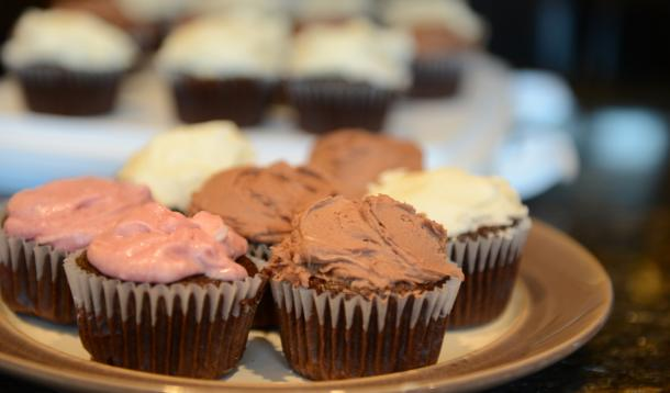 chocolate cupcakes with various frostings