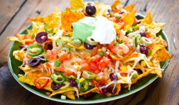 Everybody loves nachos, but they're a high-calorie, low-nutritiontreat. These tips will make your nachos a better-for-you treat, so you can indulge without guilt!   Nutrition   YMCFood   YummyMummyClub.ca