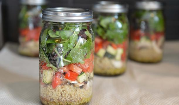 quinoa, vegetables, and greens in a jar