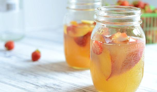 This white wine sangria is sweetened with peach nectar and ripe strawberries to make a perfect summer drink!