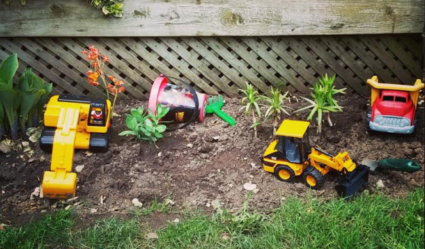 trucks, front end loader, little boy, toddler, truck addiction, gender neutral toys, Gender, boys, forklift, backhoe