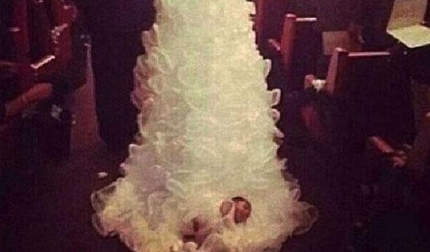 baby on wedding dress