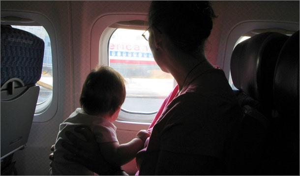 baby flying on plane
