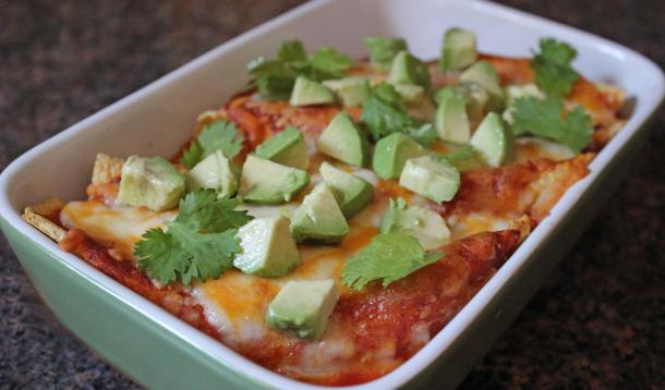 Turn a store-bought rotisserie chicken into this Easy Cheesy Chicken Enchiladas recipe for a tasty Mexican meal for the Super Bowl... or any occasion!   YMC   YummyMummyClub.ca