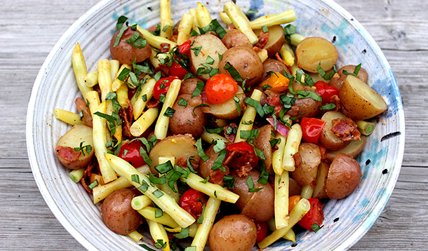 We like to eat this Warm Potato Salad with Bacon Vinaigrette while still warm, but I can confirm that it's equally delicious at room temperature and straight out of the fridge. It's a great picnic option too, since there's no mayonnaise in the recipe.