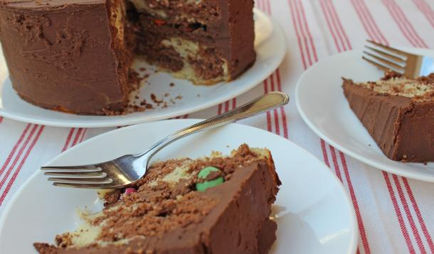 This delicious swirled vanilla and chocolate layer cake with rich chocolate buttercream and smarties in the middleisa kid-friendly surprise! | YMCFood | YummyMummyClub.ca