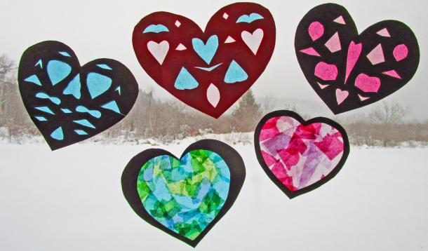 Teach your kids how to make these faux stained-glass paperhearts for decorating your windows onValentine's Day. | KidCrafts | YummyMummyClub.ca