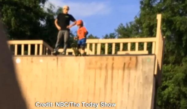 skateboard kid gets pushed down ramp