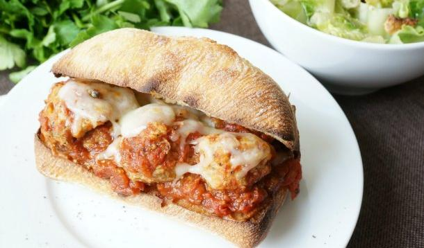 Turkey meatball subs are a great family-friendly dish, because they are versatile, they are easy to make, and the kids can help make them. The ingredients are simple, and the meatballs can be made in advance, frozen, and then popped in the delicious marinara sauce to warm them through. Add a crusty bun, some melty cheese and you have a quick weeknight dinner, or a busy hockey weekend meal. | YMCFood | YummyMummyClub.ca