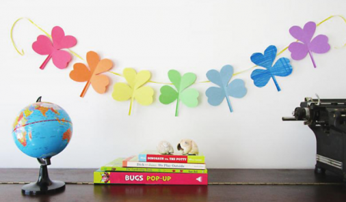 Making a shamrock garland using rainbow paper is a terrific St. Patrick's Day activity for kids.