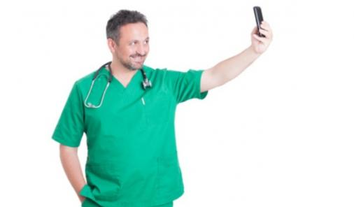 Doctors taking selfies with patients