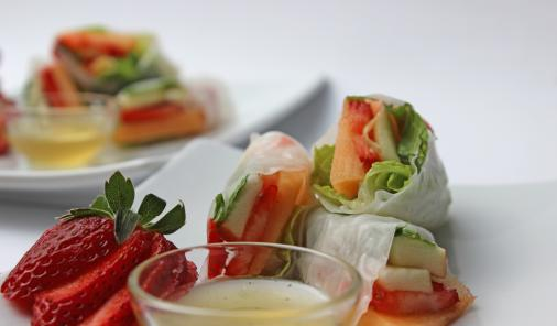 Fill rice paper with fresh fruit and mint leaves instead of vegetables and herbs for a fresh twist on summer rolls