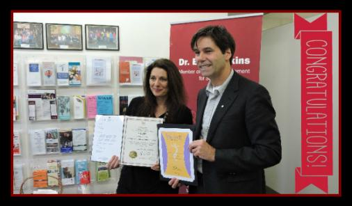 Erica Ehm gets leadership award from MPP Dr. Eric Hoskins