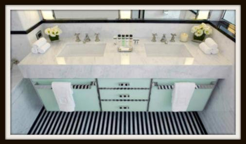The Mark Hotel bathroom in mint and black.