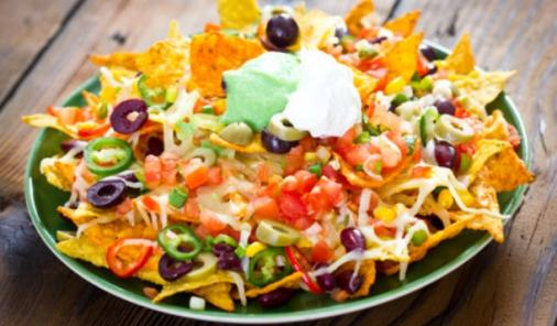Everybody loves nachos, but they're a high-calorie, low-nutrition treat. These tips will make your nachos a better-for-you treat, so you can indulge without guilt! | Nutrition | YMCFood | YummyMummyClub.ca