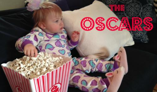 Baby watching a movie in pyjamas with popcorn