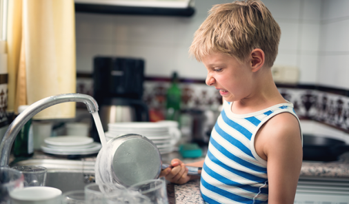 Boy cleaning dishes