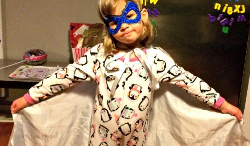 Little girl dressed as a superhero