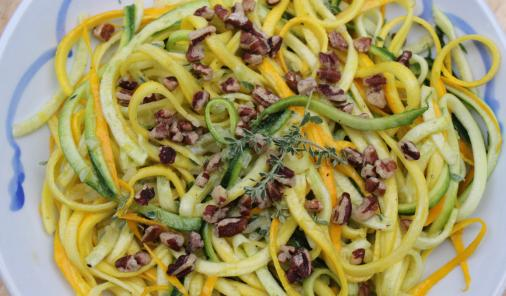 Spiralized zucchini and a zippy dressing make this an easy, delicious salad
