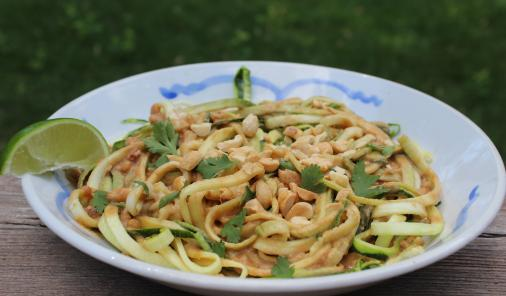spiralized raw zucchini noodles with spicy ginger peanut dressing