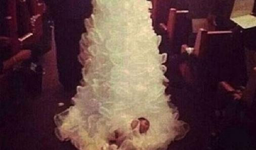 baby on wedding dress