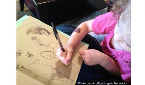 child helping mom with artwork