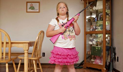 child holding gun