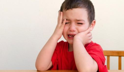 child_crying_at_table