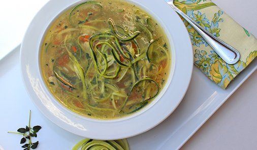 Chicken Soup with Zucchini Noodles is a great way to use your spiralizer, and it's a great way to cut out the starchy carbs for a healthy garden fresh twist on an old classic in less than 30 minutes. | Gluten free | YMC