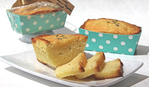 This quick-to-make Glazed Lemon-Thyme Loaf recipe is full of bright, lemony flavour. The addition of fresh thyme leaves to the loaf of bread makes it extra-special. Perfect as a gift, or for a tea party! | YMC