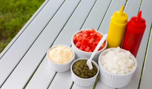 table with summer bbq condiments