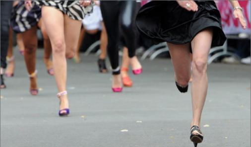 women running in high heels