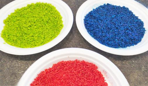 Sure, rainbow rice is fantastic when it comes to sensory play, and games but it is also a terrific material to use when creating works of art.