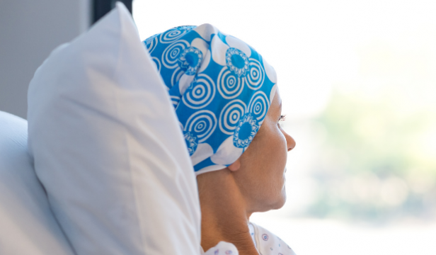 Woman with headwrap looking out window