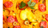 Close up photo of nachos sprinkled with cheese and tomatoes