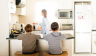 Mom In Kitchen With Two Boys