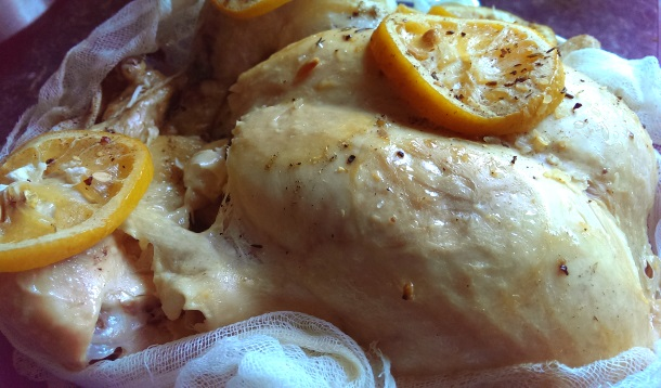 The easiest hot weeknight dinner you'll ever make with a whole chicken! No thawing required with this fast melt-in-your-mouth crockpot lemon chicken recipe. | slow cooker | school meals |