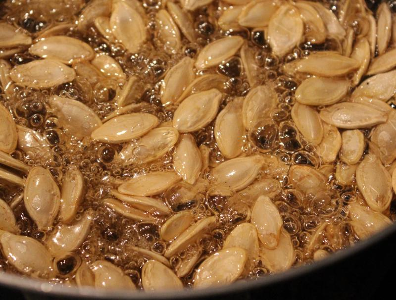 After carving the pumpkin, make some Roasted Pumpkin Seed Brittle recipe this Halloween! Not only is this sweet treat delicious on its own, you can use it as a pretty fall garnish for cheesecake or panna cotta. All you need is a candy thermometer! | YMCFood | YummyMummyClub.ca