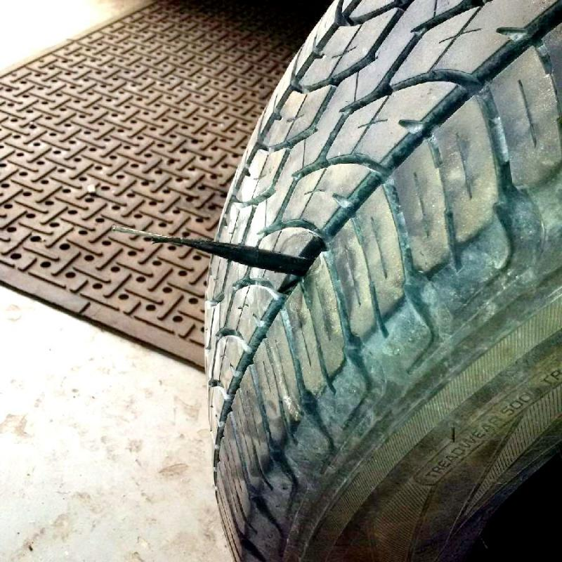 Tire plug and patch combination installed