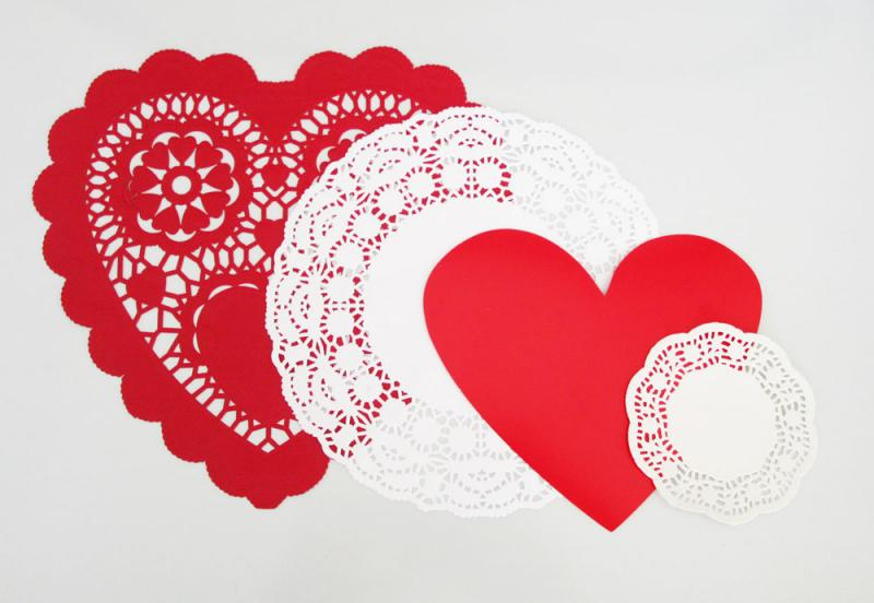 Layering doilies and heart cut-outs to make vintage Valentines