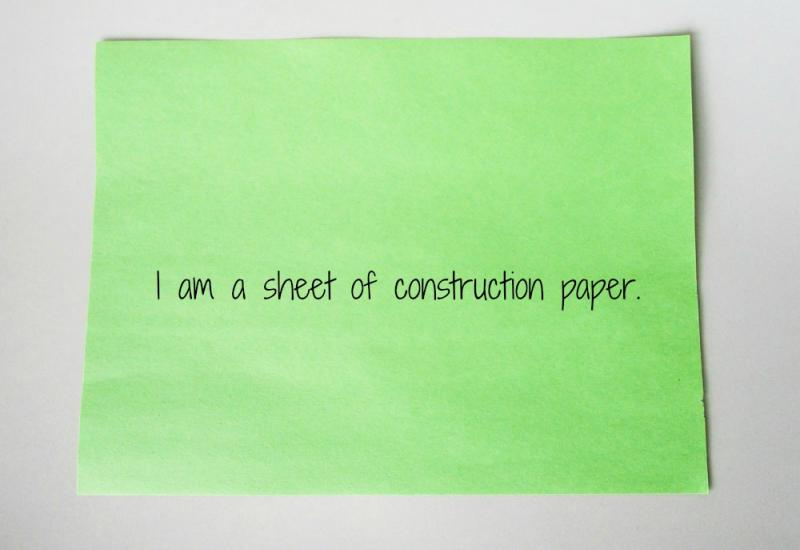 Start with a sheet of construction paper.