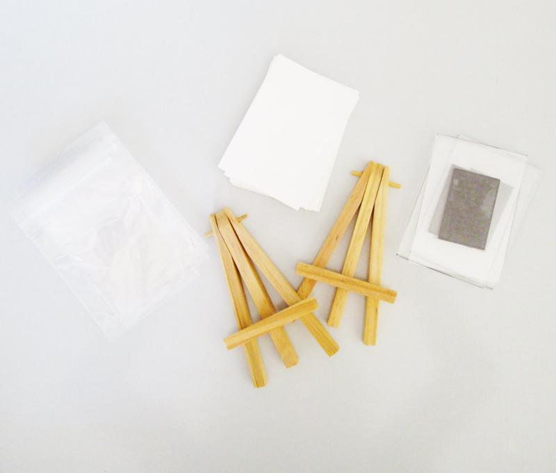 Accessories for artist trading cards include mini easels, little bags and magnetic frames.