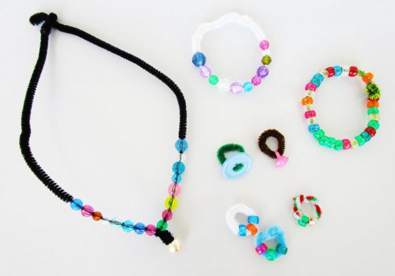 Make jewellery using beads and pipe cleaners.
