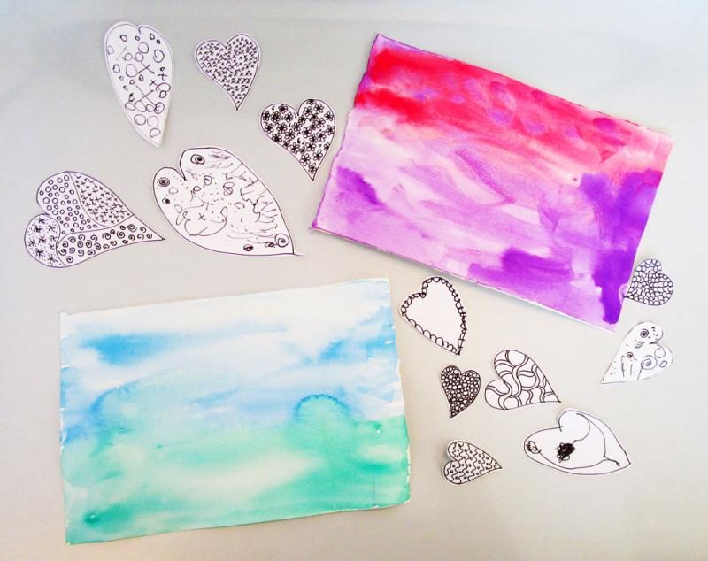 Heart cut outs and watercolour paintings.