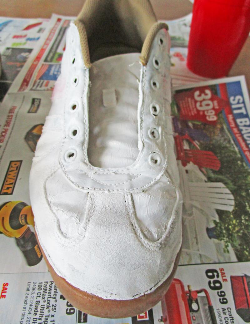 Give the shoes a base coat of paint.