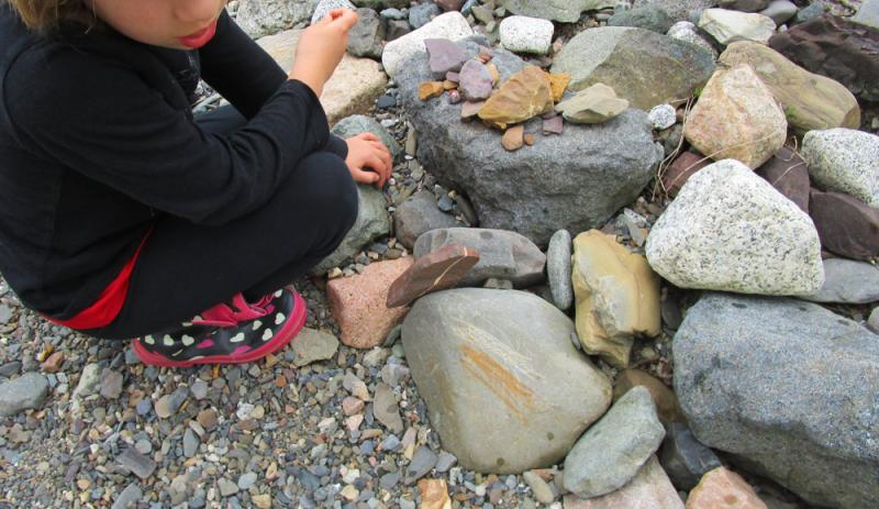Draw with rocks, on other rocks.
