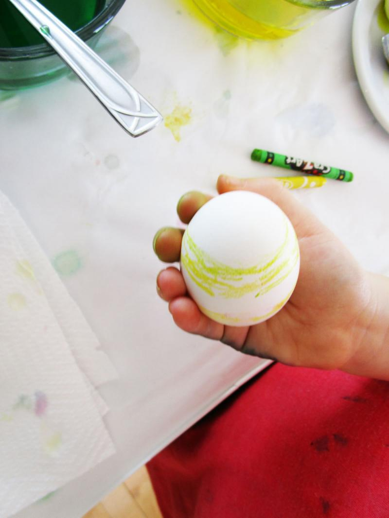 A hard boiled egg with crayon decorations.