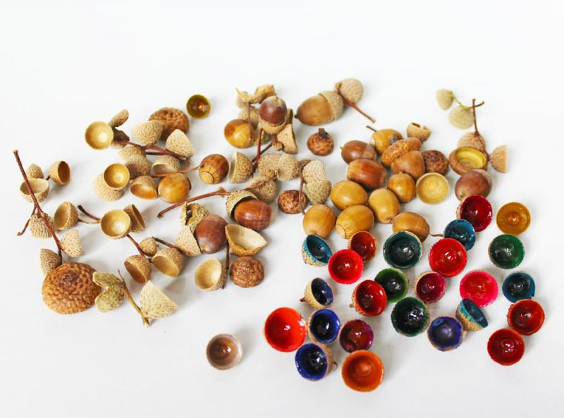 These sweet little jewels are lovely on their own or can be used for crafting projects such as necklace charms, wreath embellishments or nature bracelets. My daughter even uses them as decorations when she makes fairy houses.  Turning acorn caps into gems is doable for kids of any age. Here's how to make your own. | YMC