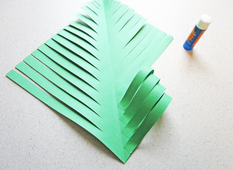 Fold the strips of paper into the centre.