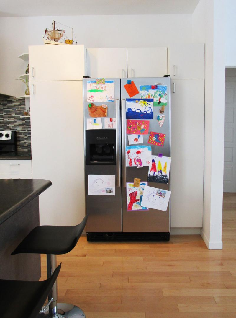 A fridge full of kid's art.